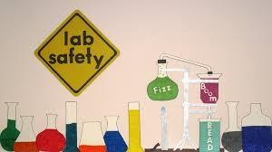Lab with test tubes and Lab Safety Sign